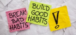 three post it notes with bad habits good habits and an exclamation mark wrote on them