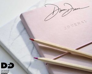 journal with donna dunne fitness signature on it